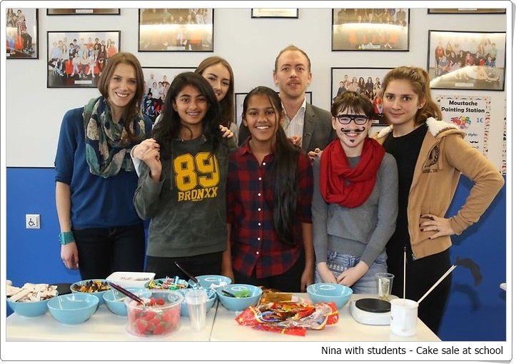 Nina With students - Cake sale at school